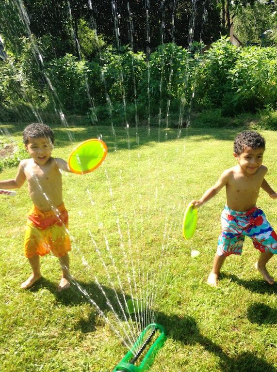 Boys in sprinkler