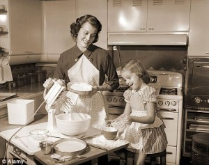 vintage mom and child making cake